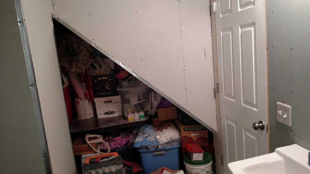 triangle opening of closet under stairs