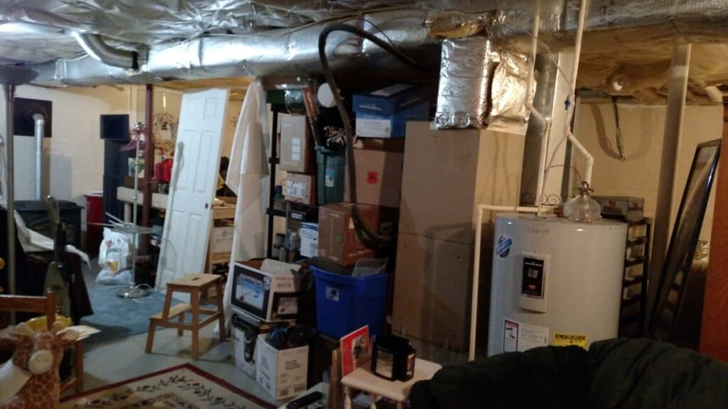 mess of boxes and storage in basement
