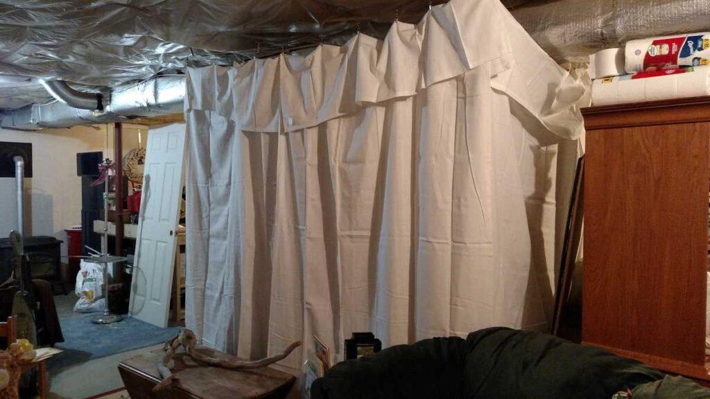 curtains hiding messy basement
