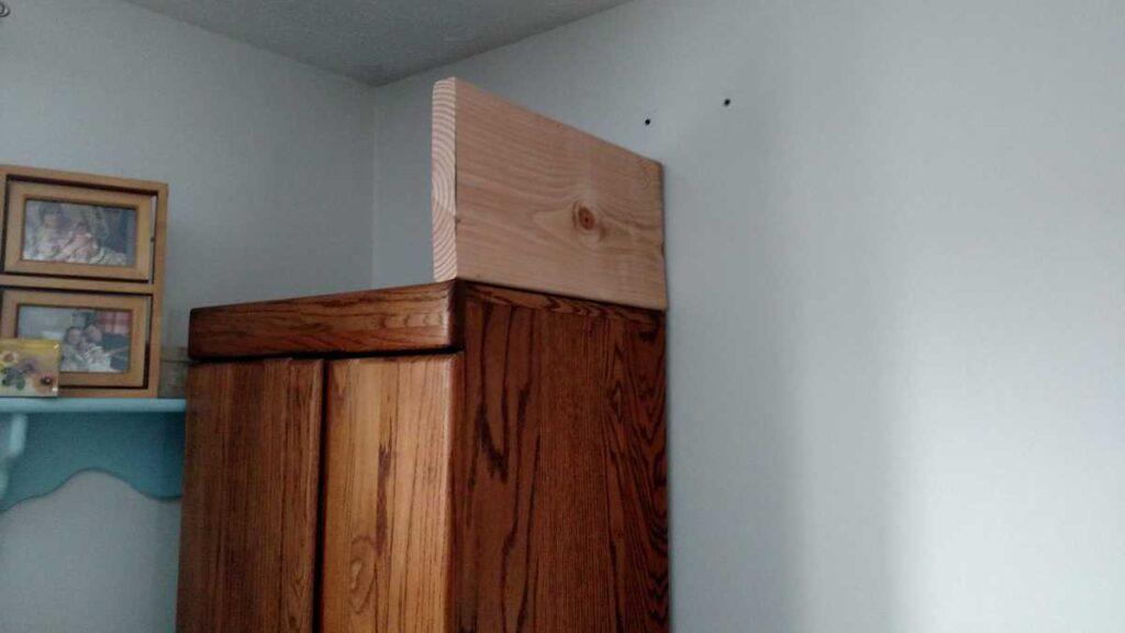 board on top of wardrobe