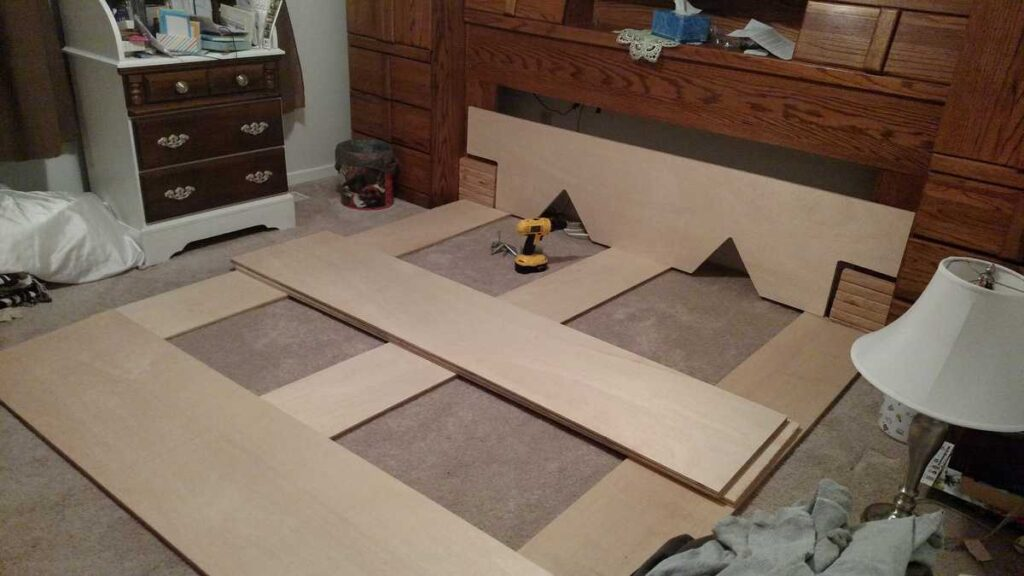 pieces of a platform bed before it is assembled