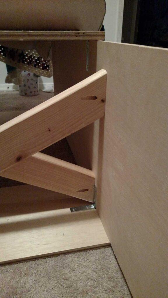 closeup of X braces inside platform storage bed
