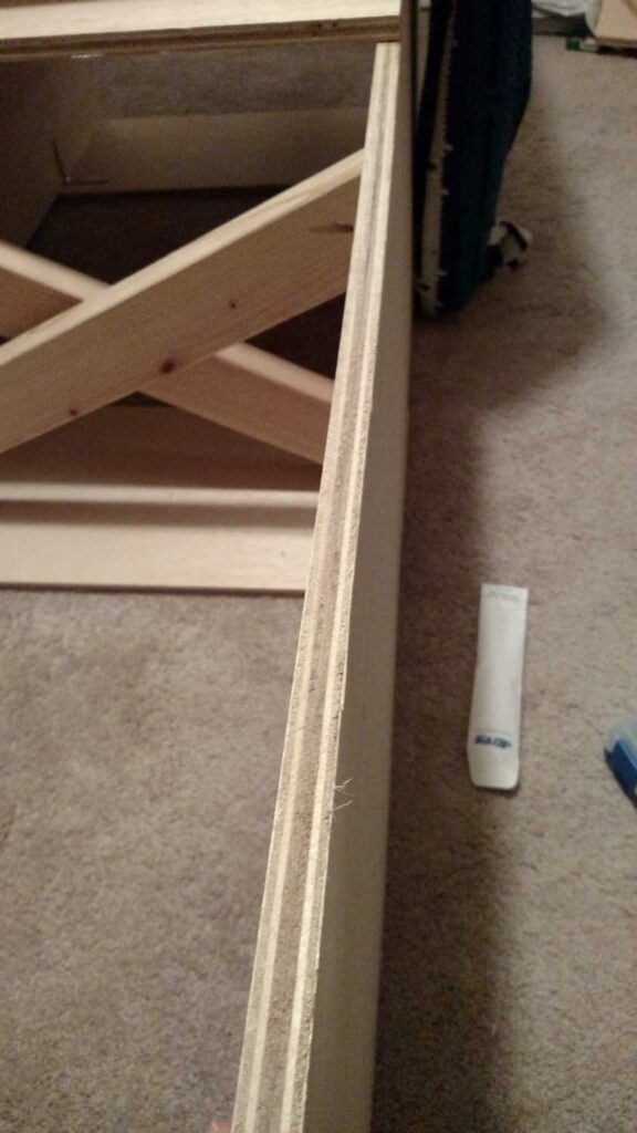 view showing how the screws do not go through the footboard of storage bed