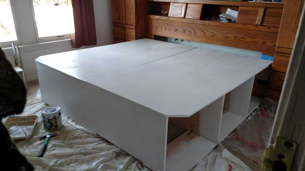 platform storage bed painted in white