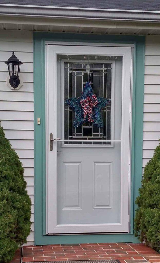 door with blue star wreath