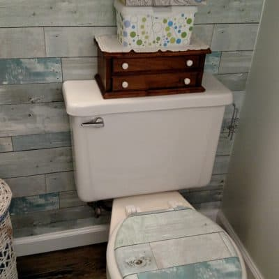 wallpapered toilet lid
