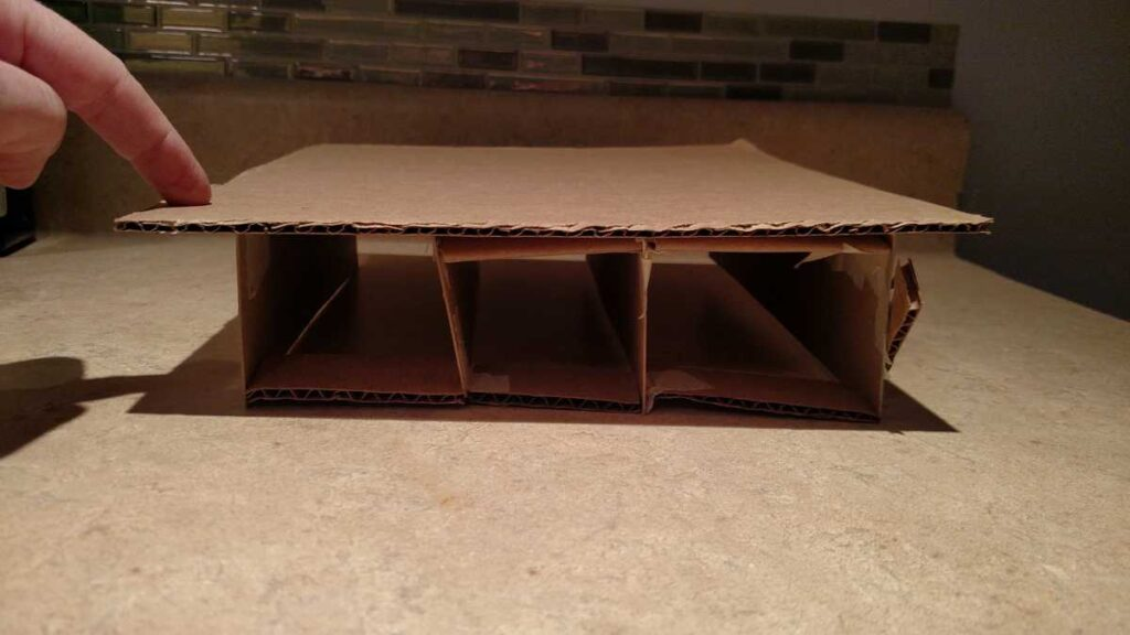 cardboard model of a storage bed