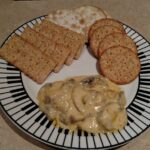 mushroom cheese dip with 3 different kinds of crackers