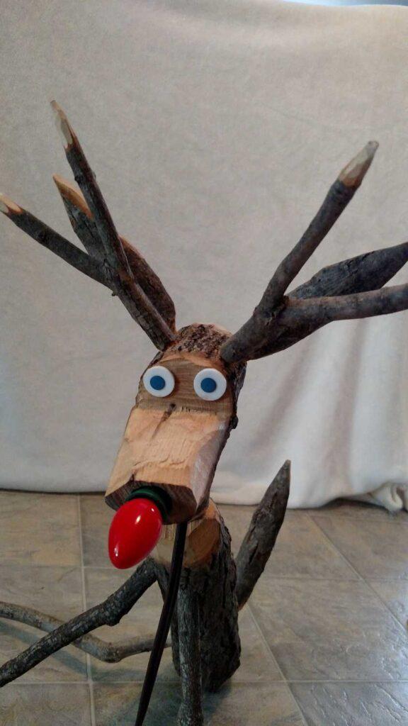 closeup of head of rustic folk wooden reindeer