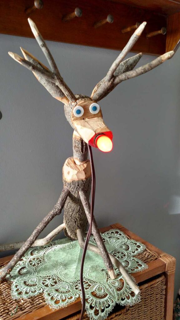 reindeer with red lightbulb nose lighted up