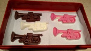 pink, brown, and white chocolate trumpets