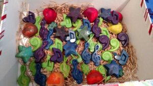 blue, purple, green, red, and orange crayons in various music and star shapes