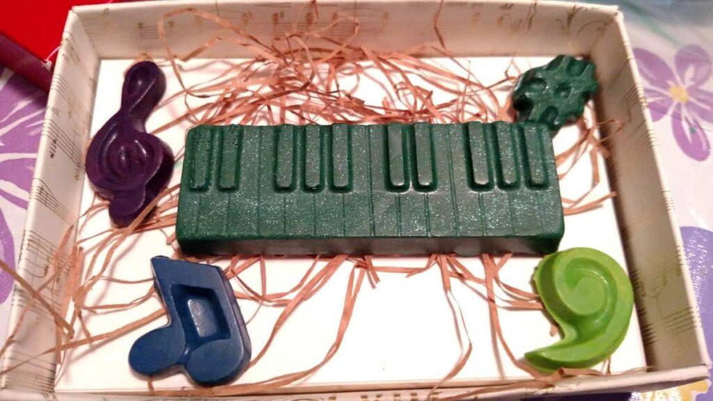 dark green crayon keyboard, purple crayon treble clef, blue crayon music note, light green bass clef, dark green sharp