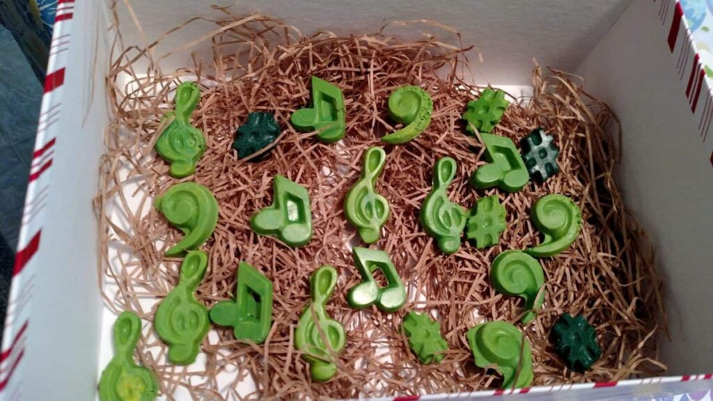 light green music notes, treble clefs, and bass clefs, with some dark green sharps