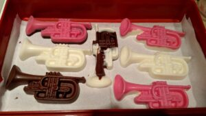various colored chocolate trumpets with pink, white, and brown