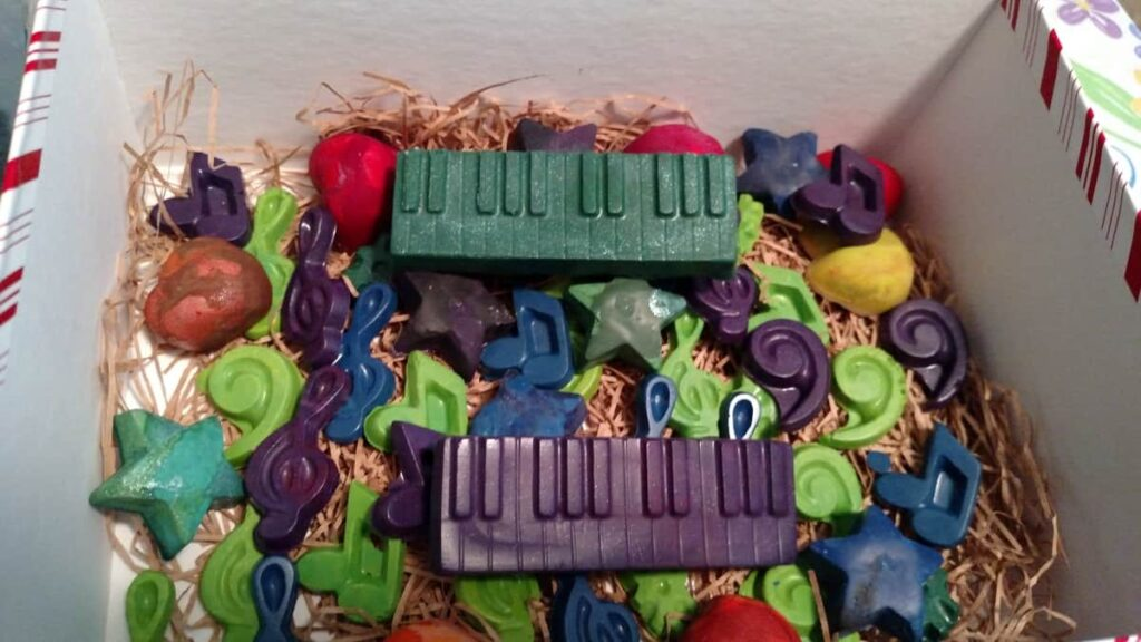 lots of various crayon shapes in music notes, a green keyboard, a purple keyboard