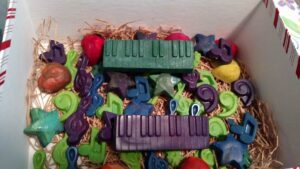 ots of various crayon shapes in music notes, a green keyboard, a purple keyboard