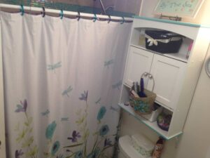 floral shower curtain in bathroom
