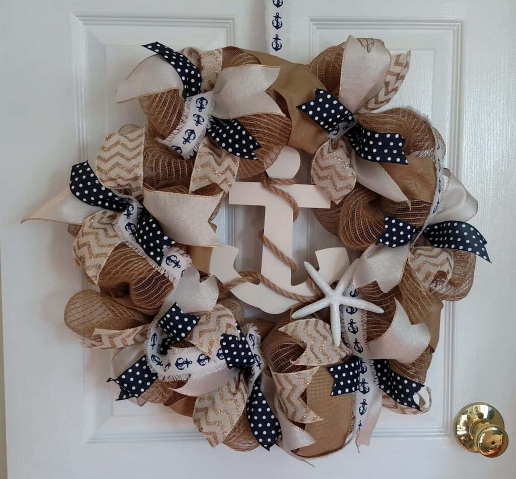 a nautical themed wreath with an anchor and rope in the center