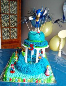 Sonic the Hedgehog 5th birthday cake with a Sonic toy on top