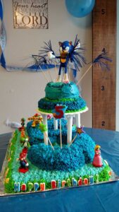 two layers of cake with Sonic the Hedgehog toy on top