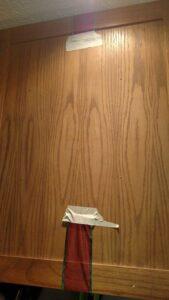 masking tape holding ribbon to door
