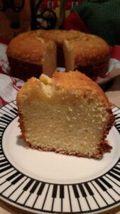 slice of pound cake with cake in background