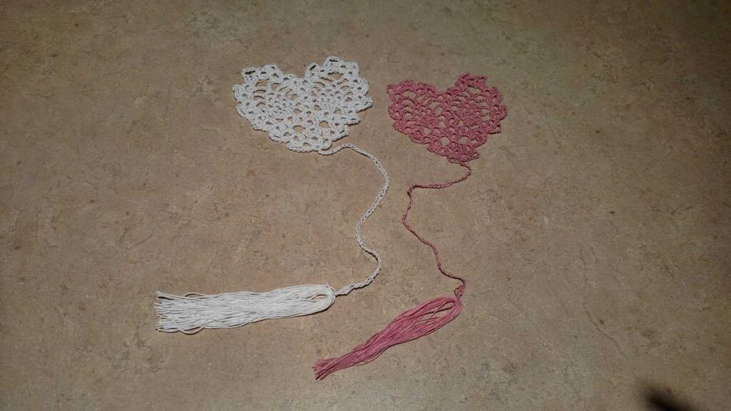 two crocheted heart shaped bookmarks