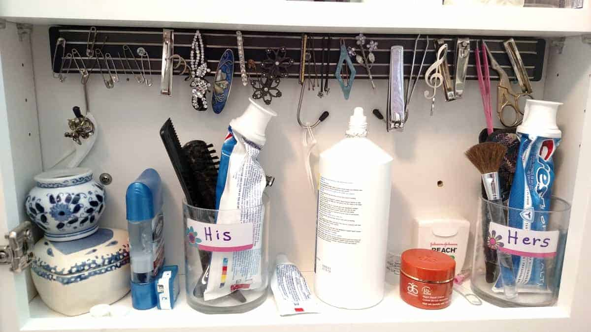 magnetic strip in medicine cabinet with lots of toothpaste tubes, contact cleanser, etc.