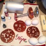 cookie press parts with 4 eggs