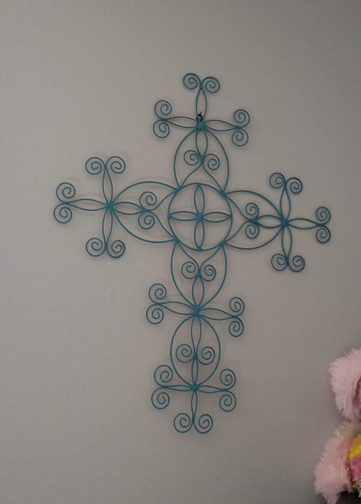 painted blue metal cross