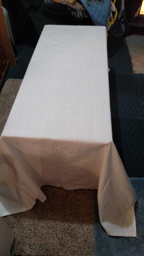 white fabric draped over storage chest