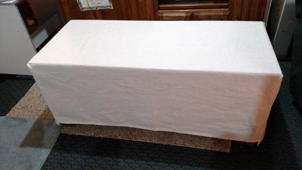 simple white cover on cedar chest