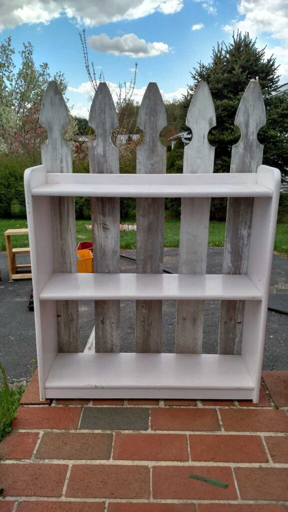 adding fence pickets to a bookcase outside