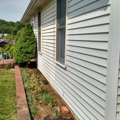 siding that is partly painted