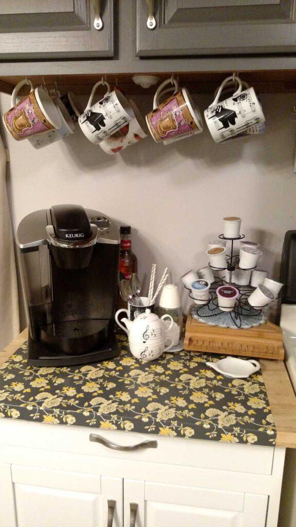 Coffee Station area with coffee maker, mugs, and coffee