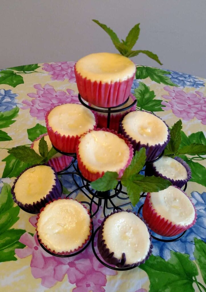 miniature cheesecakes on a tiered cupcake stand