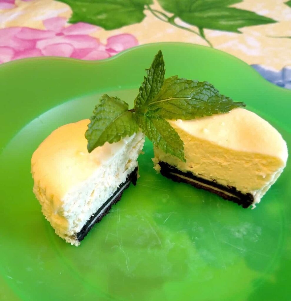 Oreo cookie crust miniature cheesecake cut in half