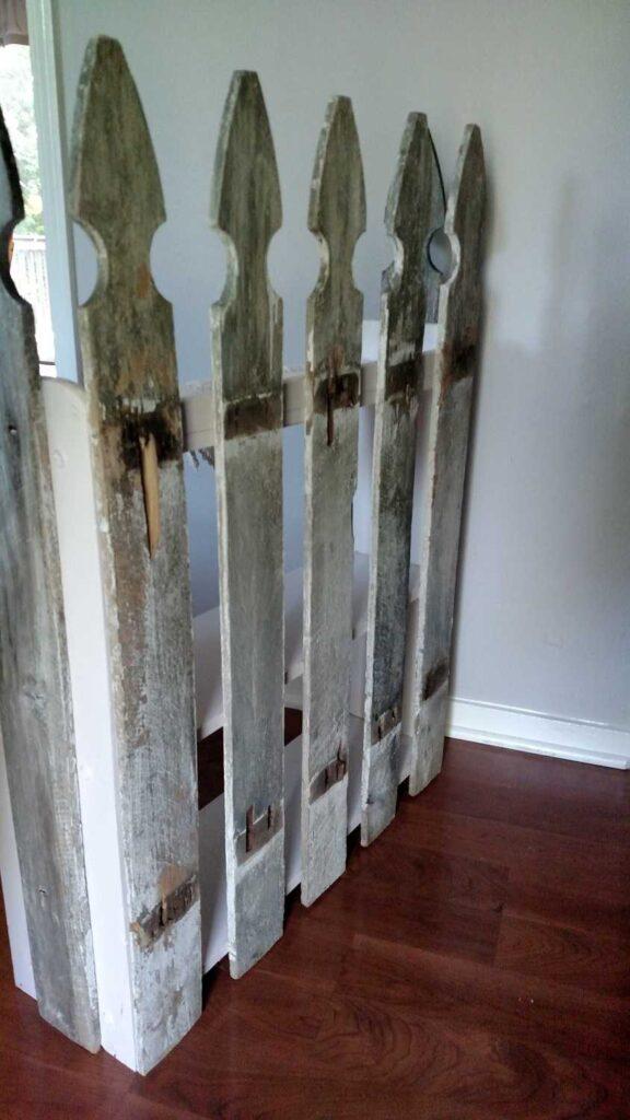 back of fence pickets on a shelf