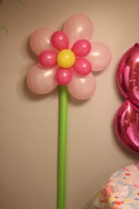 flower balloon on a pool noodle