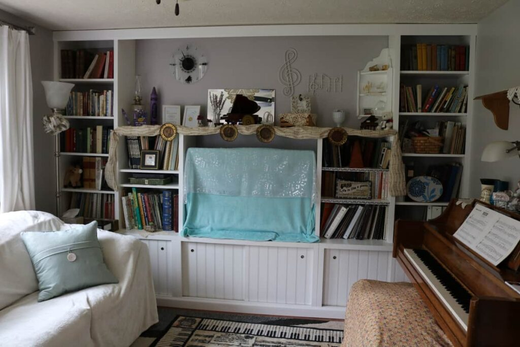 built in shelving decorated for a piano teacher