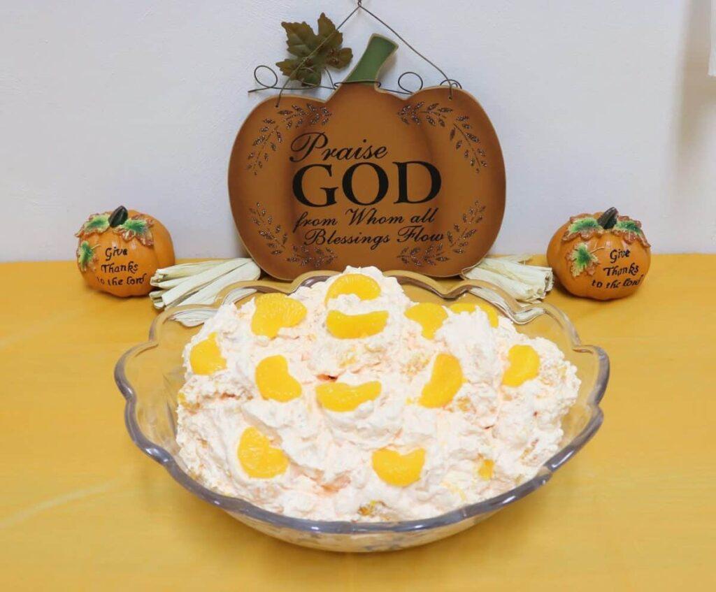 Orange Salad with wooden pumpkin in the background