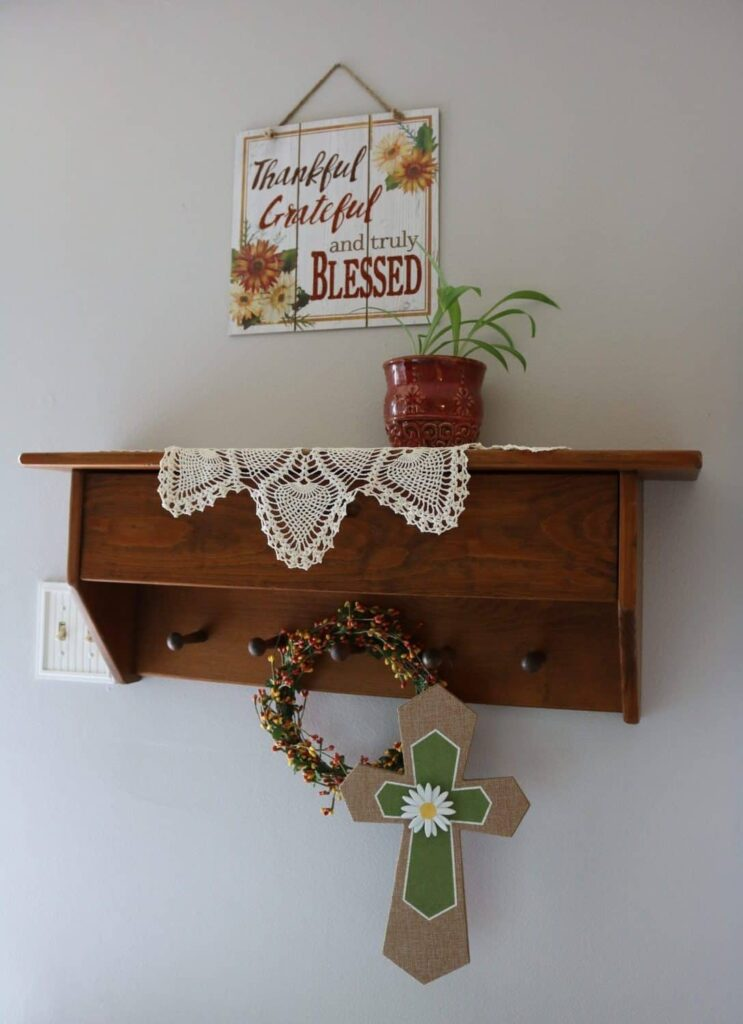 Thankful sign, plant on a wall shelf, cross on peg