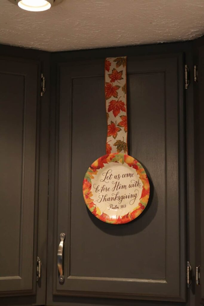 thankgiving paper plate on kitchen cabinet