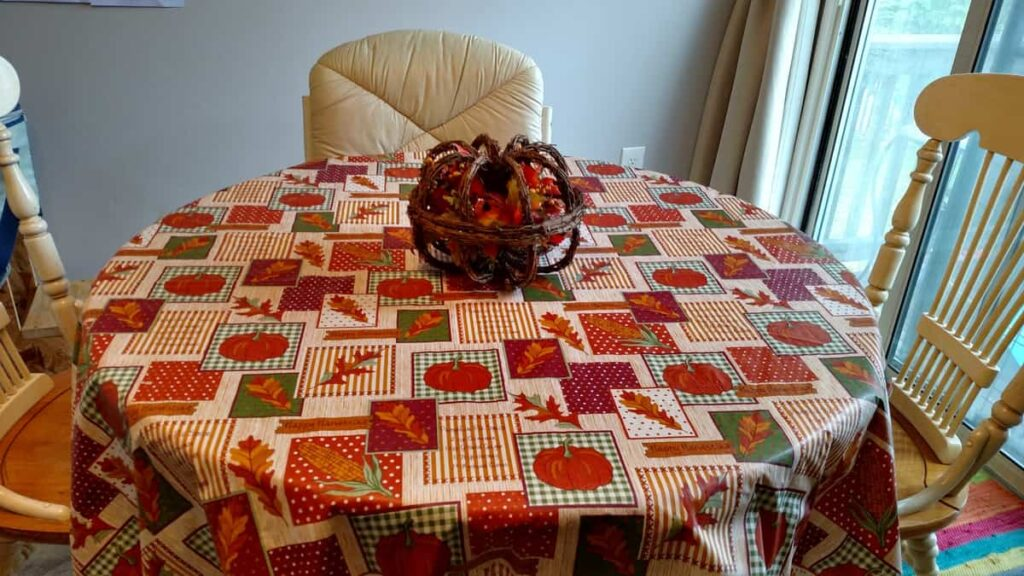 small kitchen table with fall tablecloth