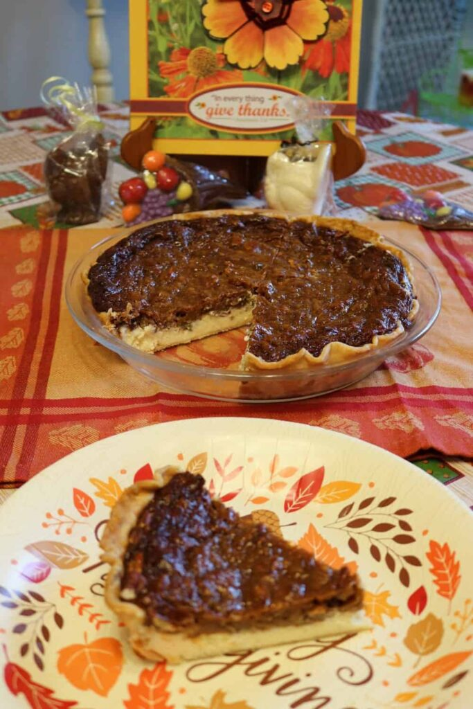 pie with piece cut out of it, and pie piece on paper plate in foreground