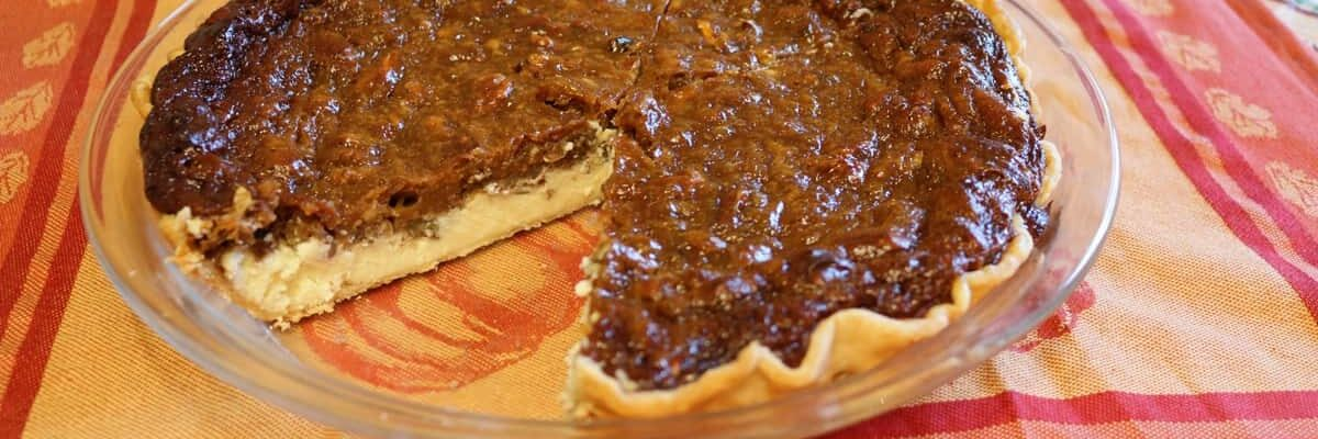 pecan cheesecake pie with slice taken out