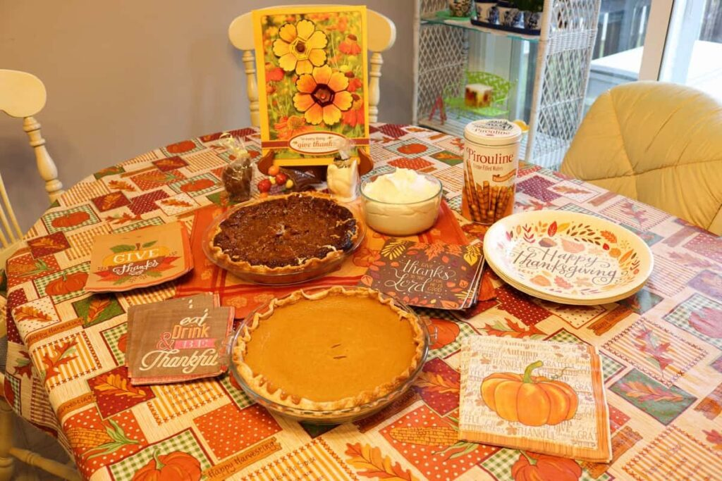 dessert table for thanksgiving including pies