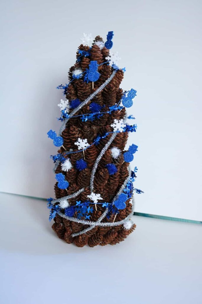 blue and white winter pine cone tree