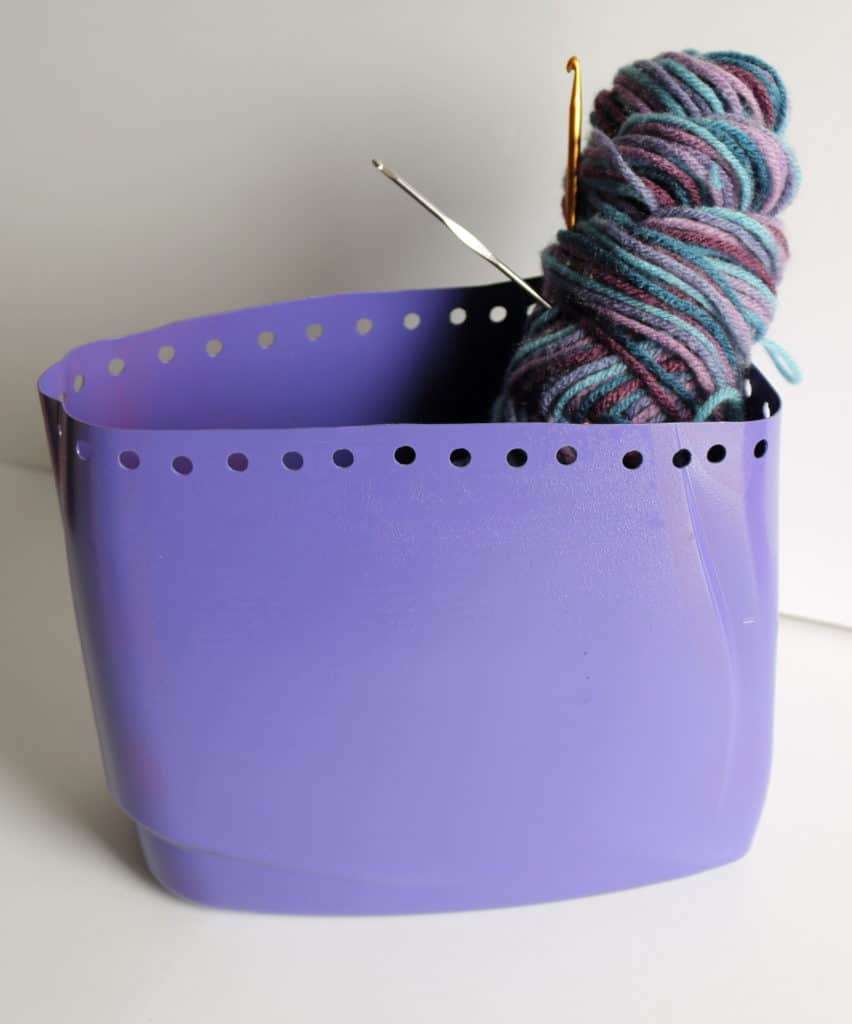 detergent container with yarn and crochet hooks